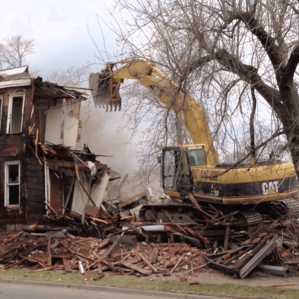 A Rochester, New York property demolition contractor removing a home.