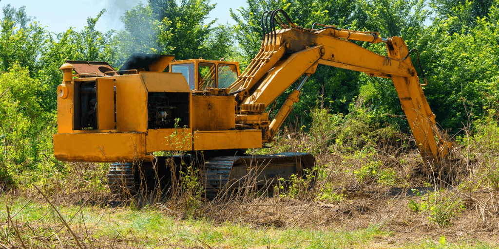 image a bulldozer clearing a demolition site.